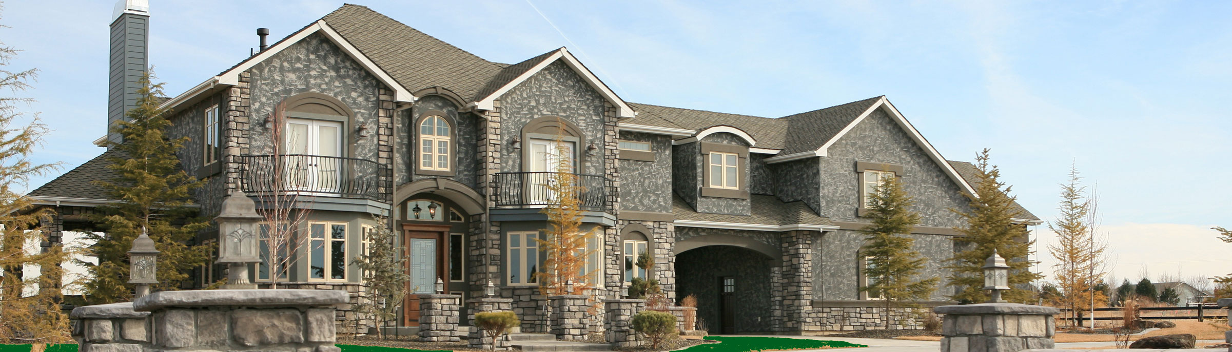 luxury home with stone facade