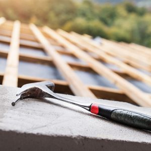 roof repair showing hammer and wood